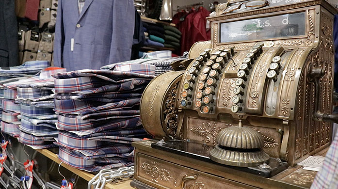 Our antique till at Cavendish Menswear, Romsey with Shirts, Shuits and Trousers